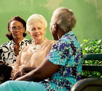 three senior women talking