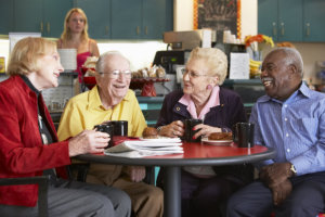 four seniors talking